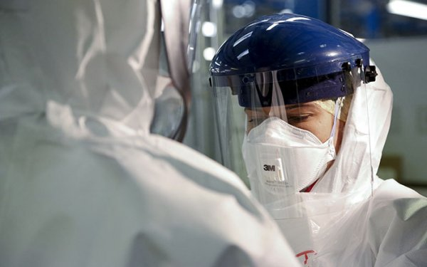 Scientist in protective clothing