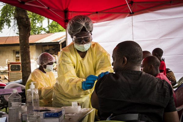 Photo shows patient being vaccinated on the front lines in the DRC